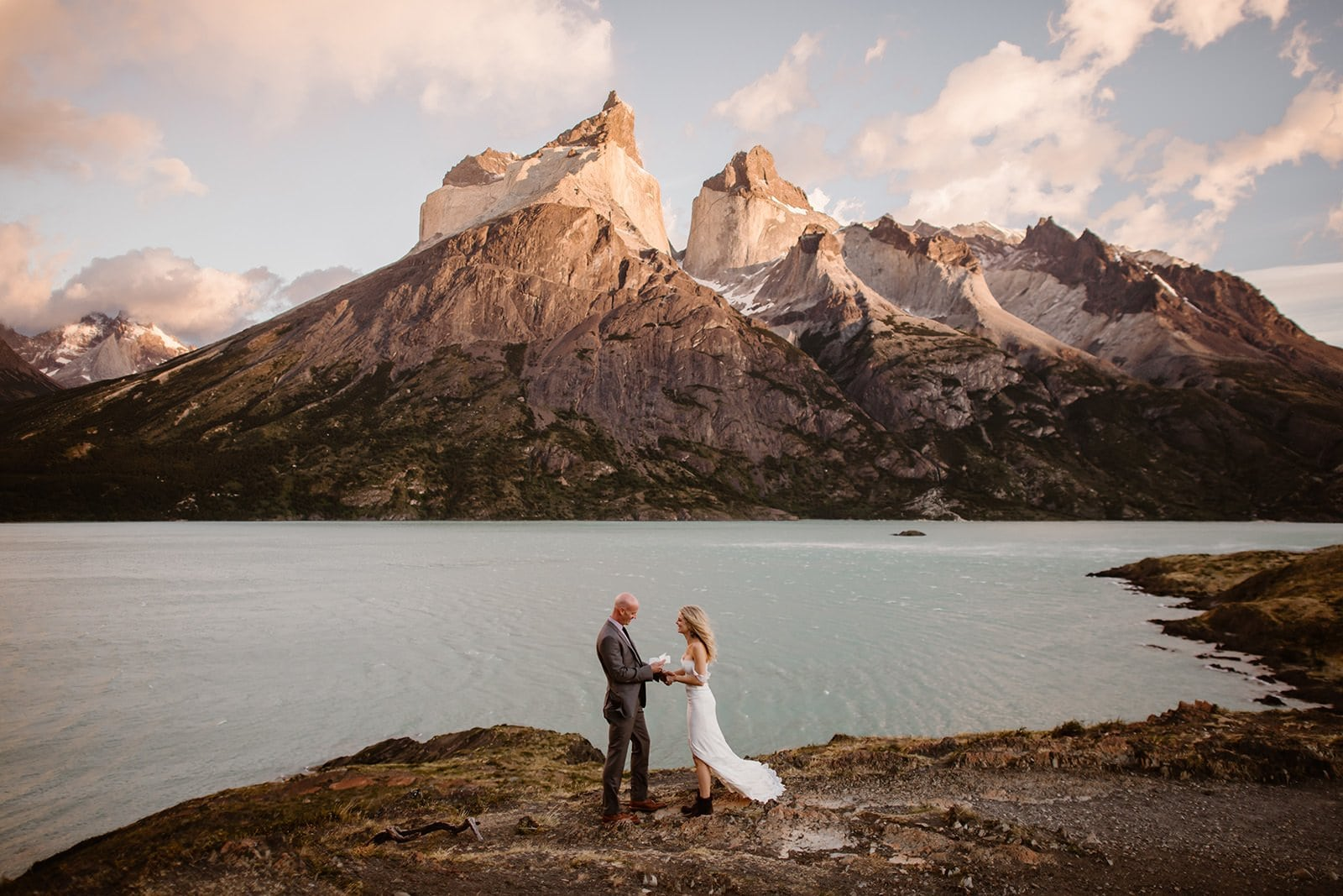 bride and groom reading elopement vows in Patagonia