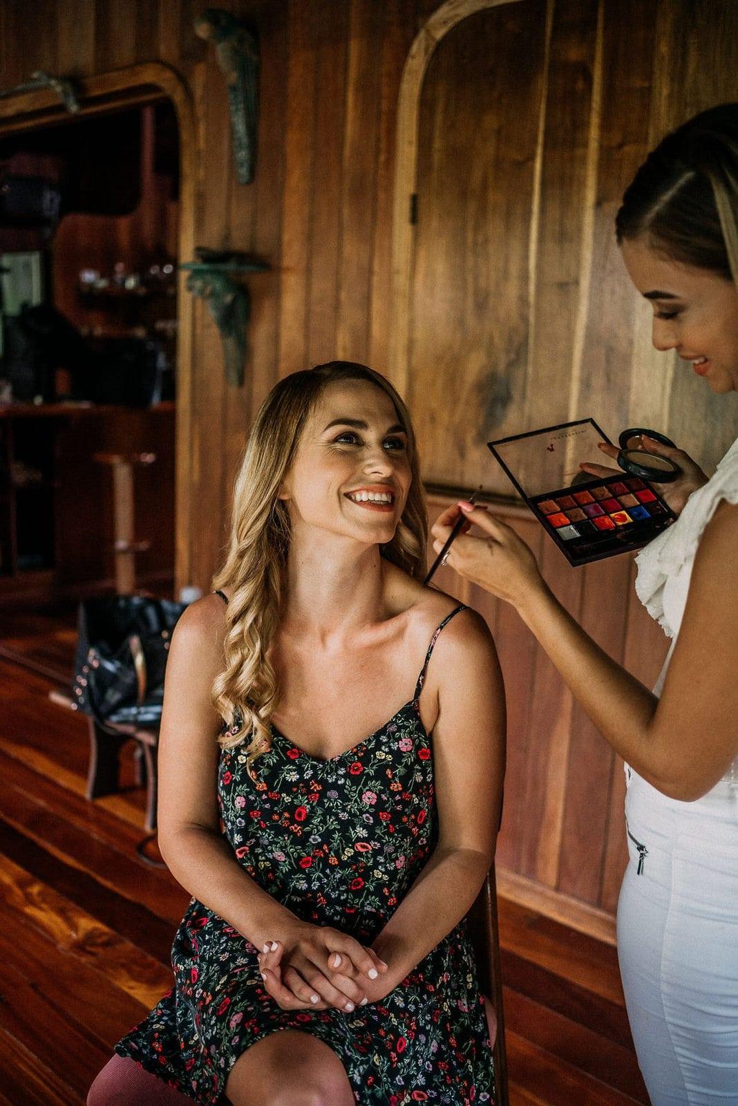 bride getting makeup done.