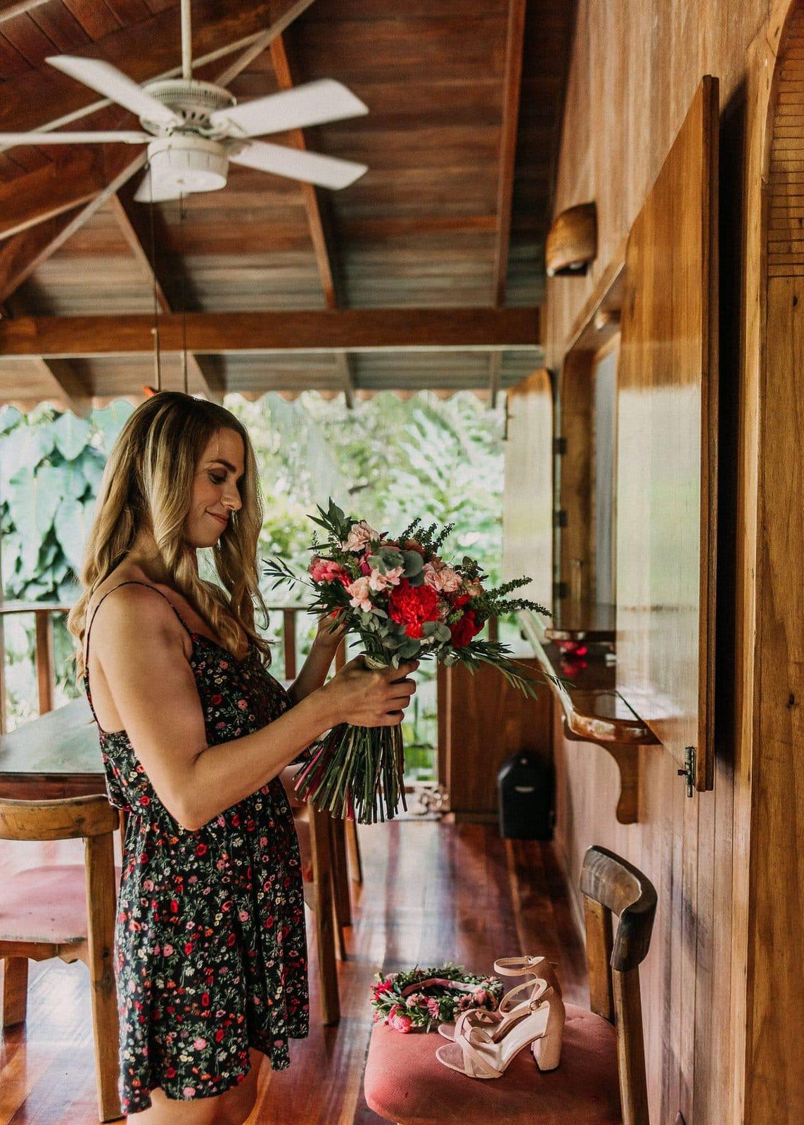 bride admiring wedding bouquet.