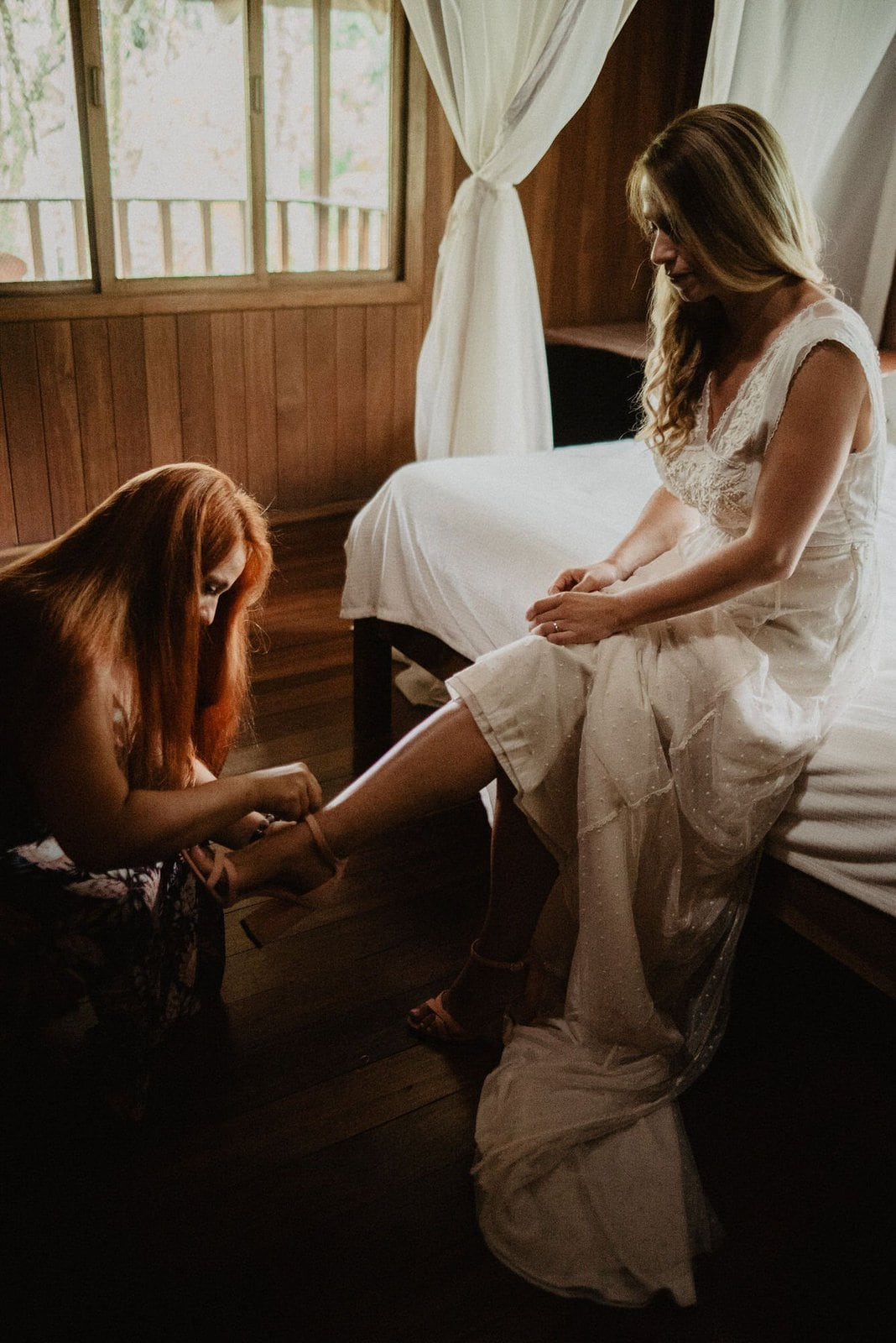 bride putting her shoes on.
