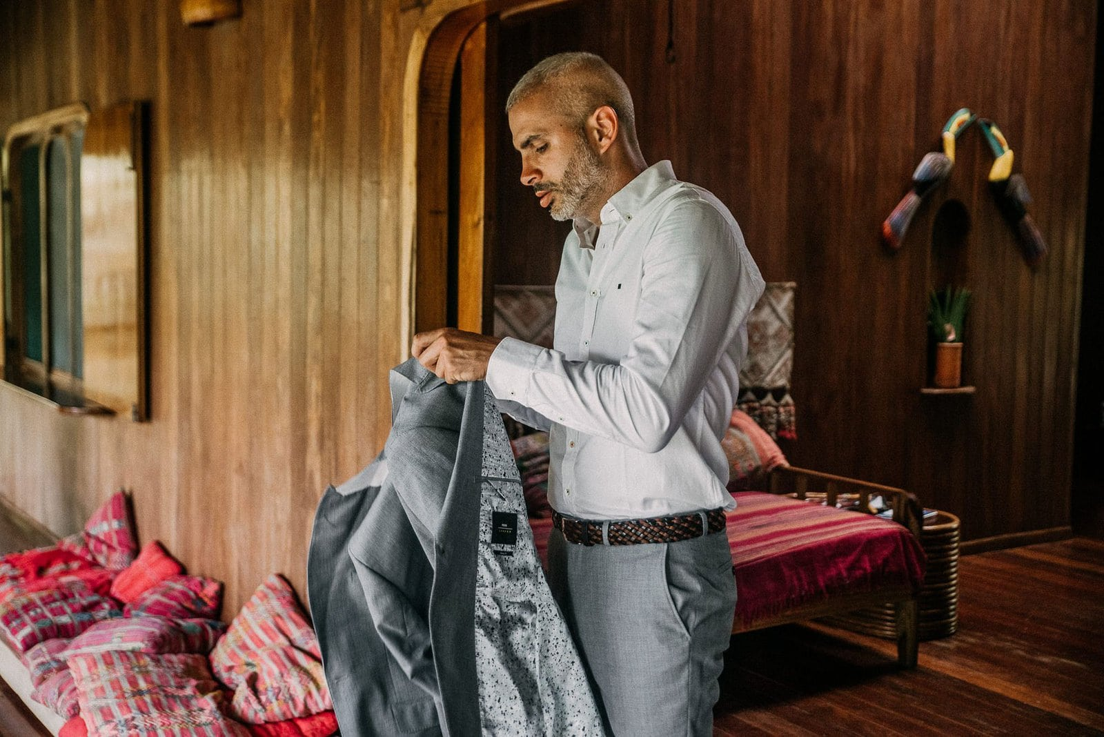 groom getting ready for costa rica elopement