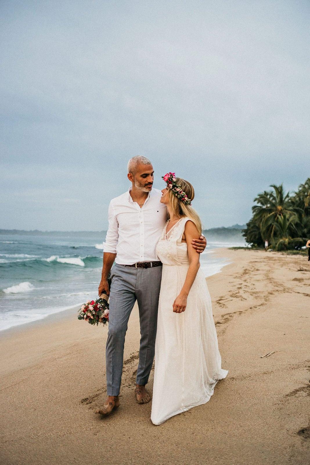 bride and groom on beach.