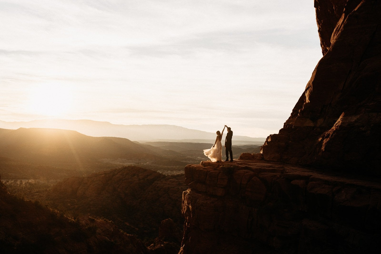 groom dancing with bride at sunset in sedona