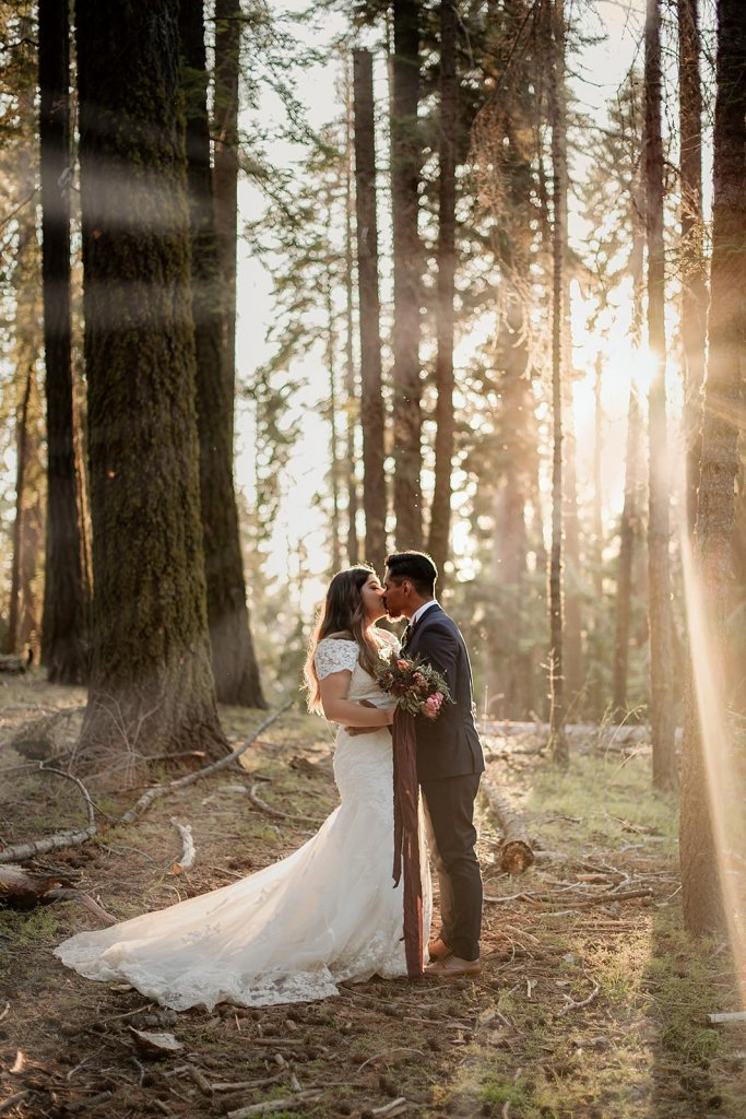 eloping in beautiful forest.