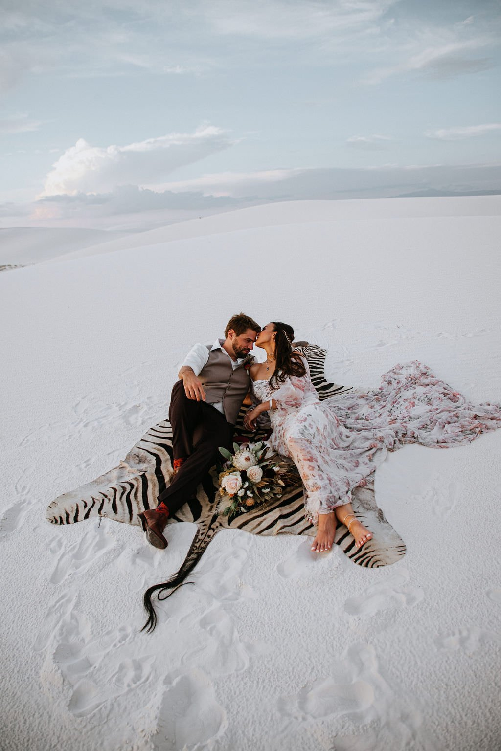 bride and groom cuddling during desert elopement.