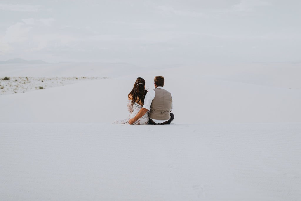 bride and groom admiring desert.