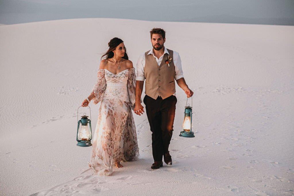 sunset as couple walk in desert.
