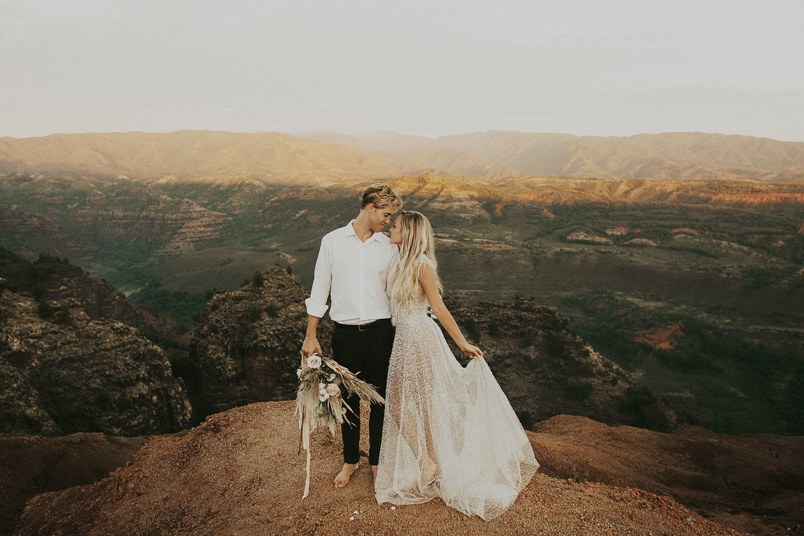 bride and groom taking wedding photos at kauai waimea canyon