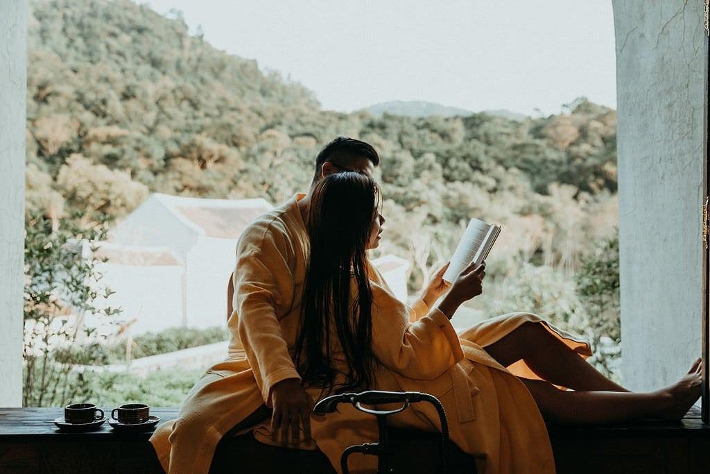 bride reading to her groom in Vietnam wedding