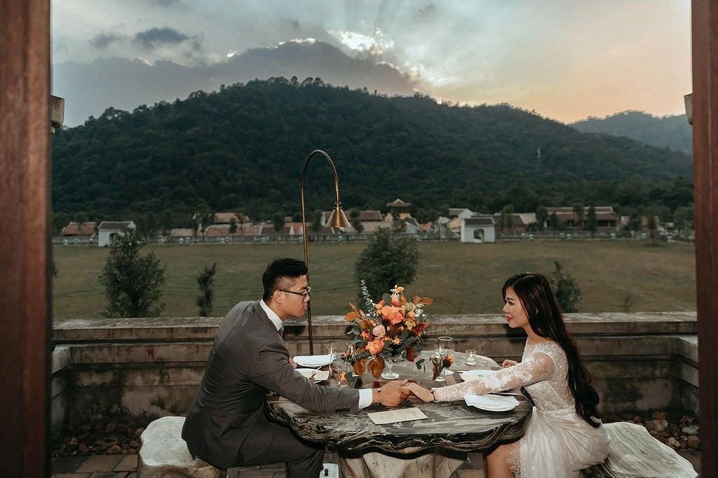 bride and groom eating during Vietnam wedding