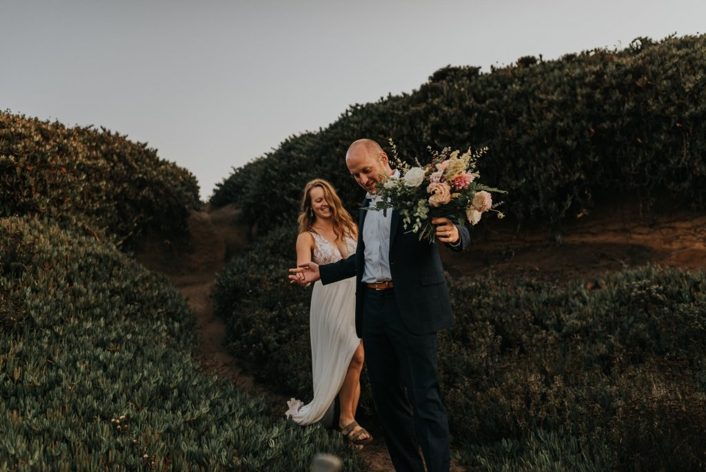 Bride and groom by California's coast.