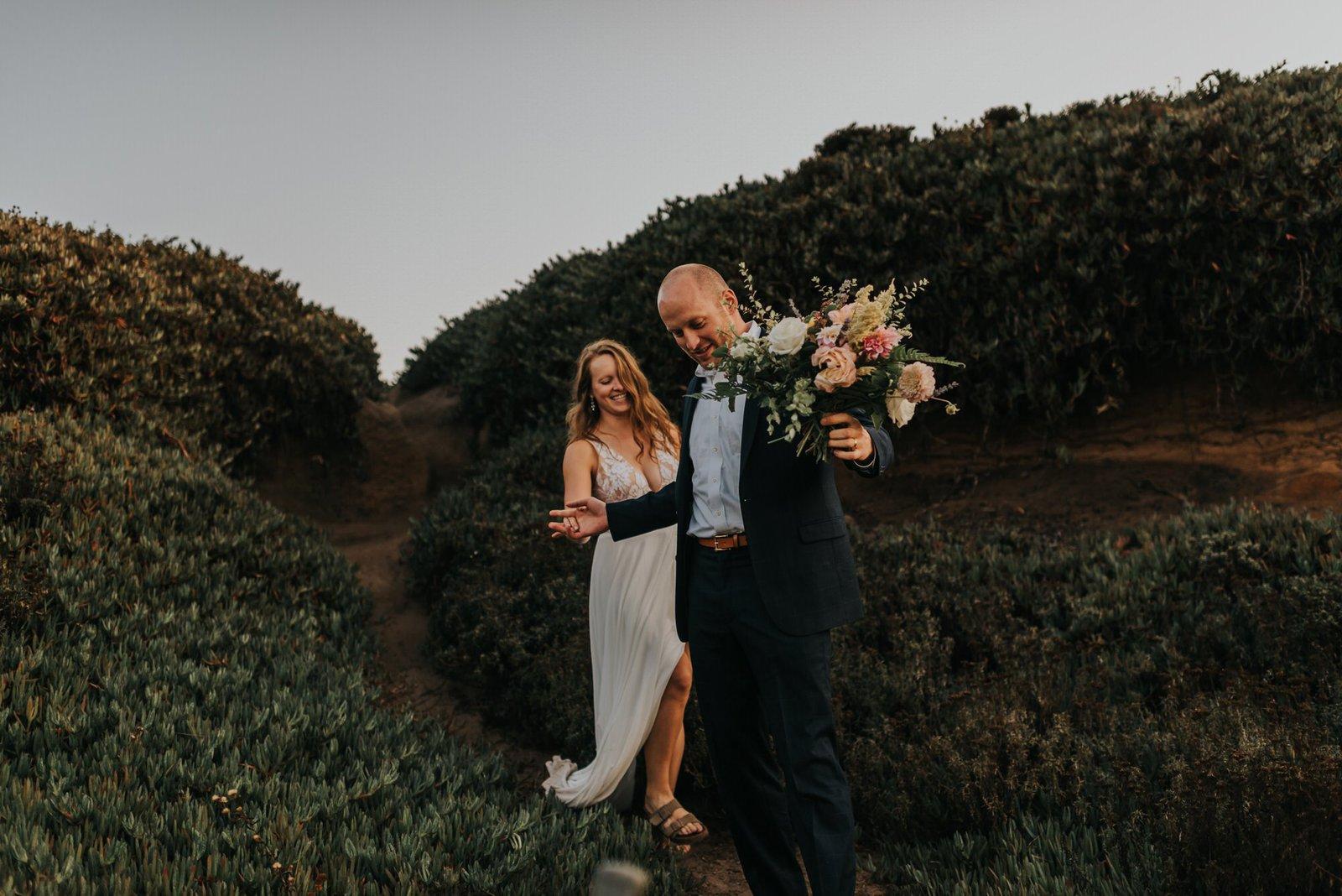 Bride and groom by California's coast.