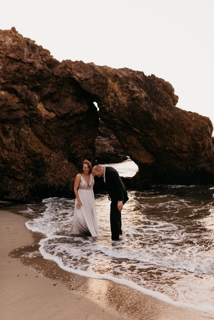 bride and groom in the beach.