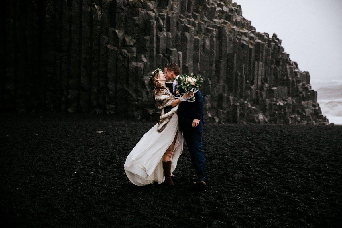 couple kissing after Reynisfjara Beach elopement