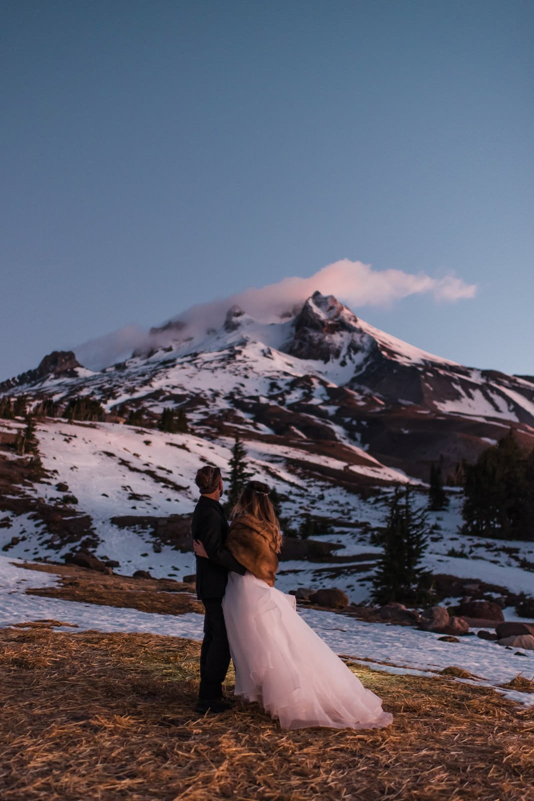 bride and groom during sunrise