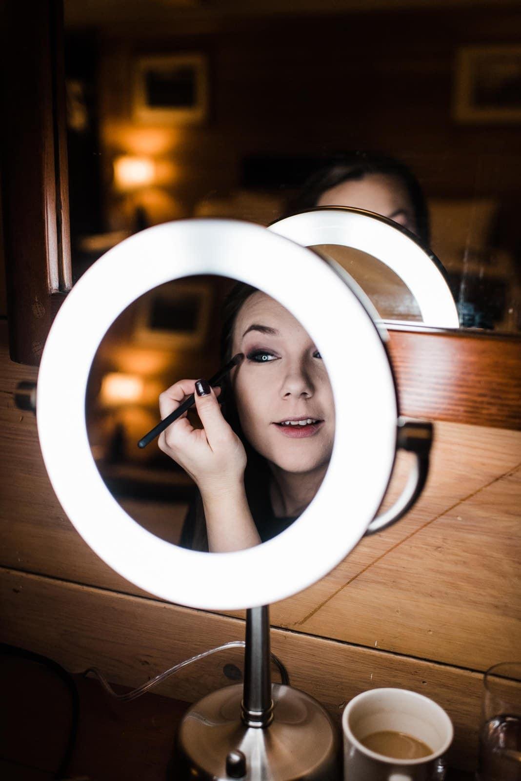 bride doing her makeup