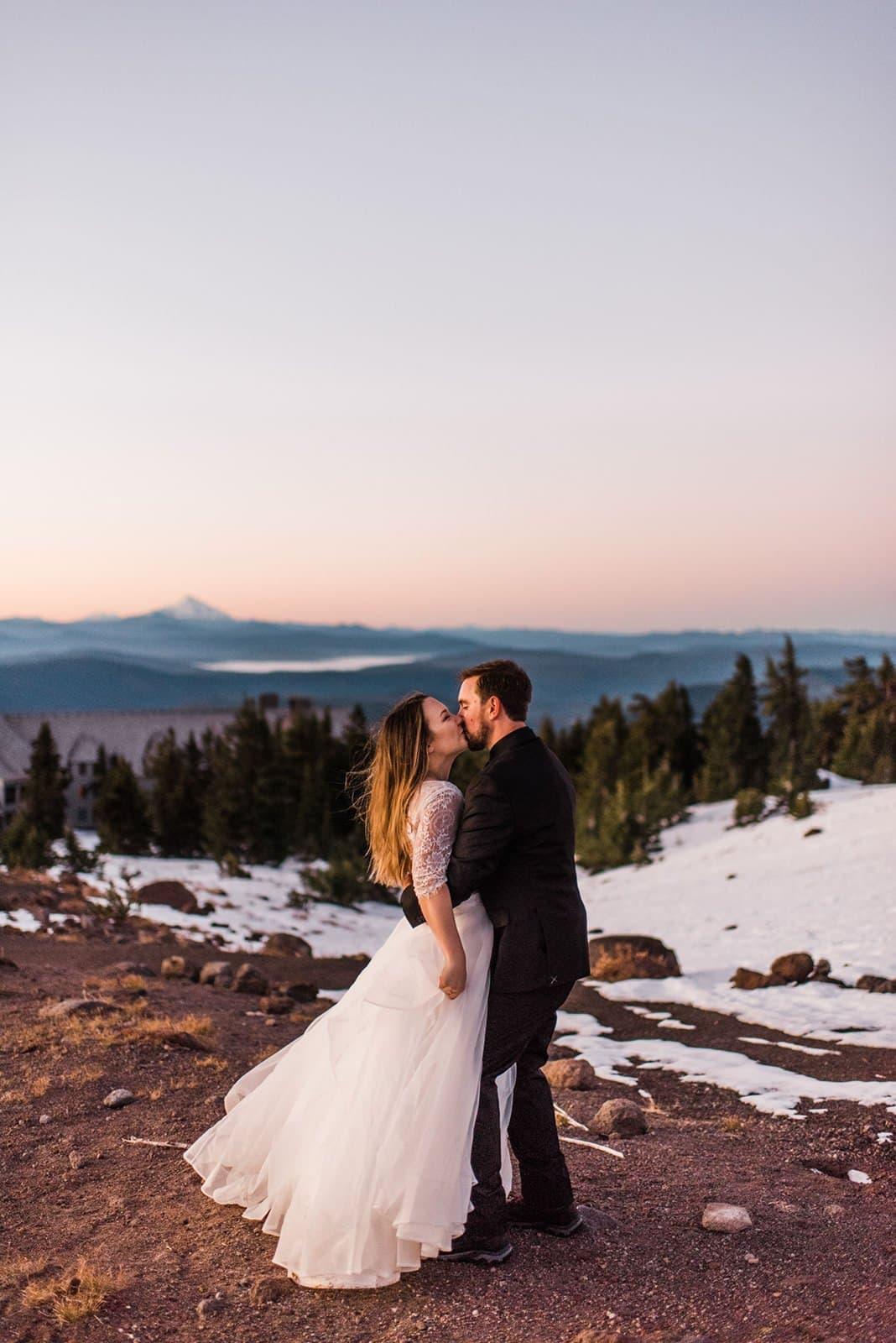 bride and groom kiss on mount hood