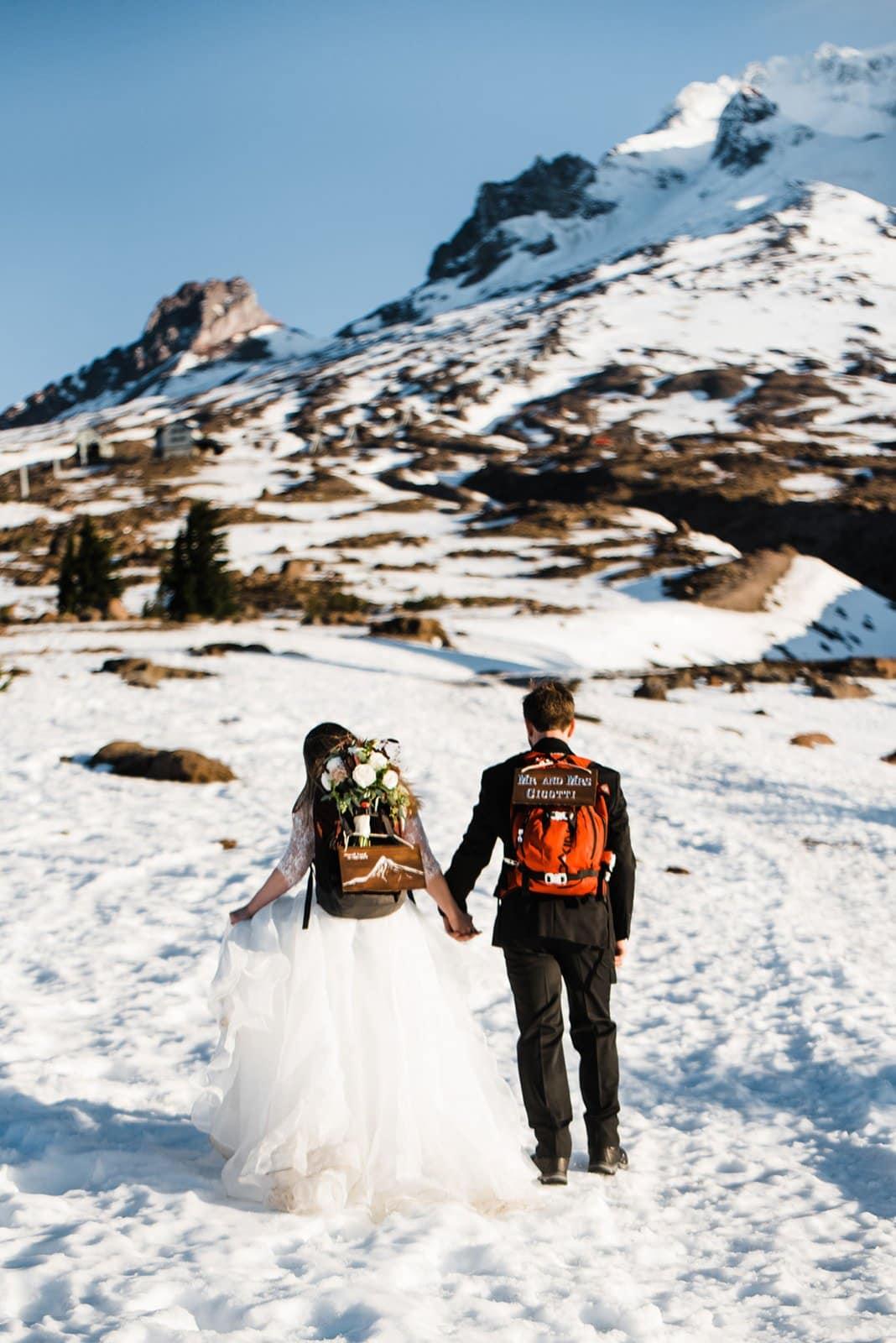 bride and groom hiking up mt. hood