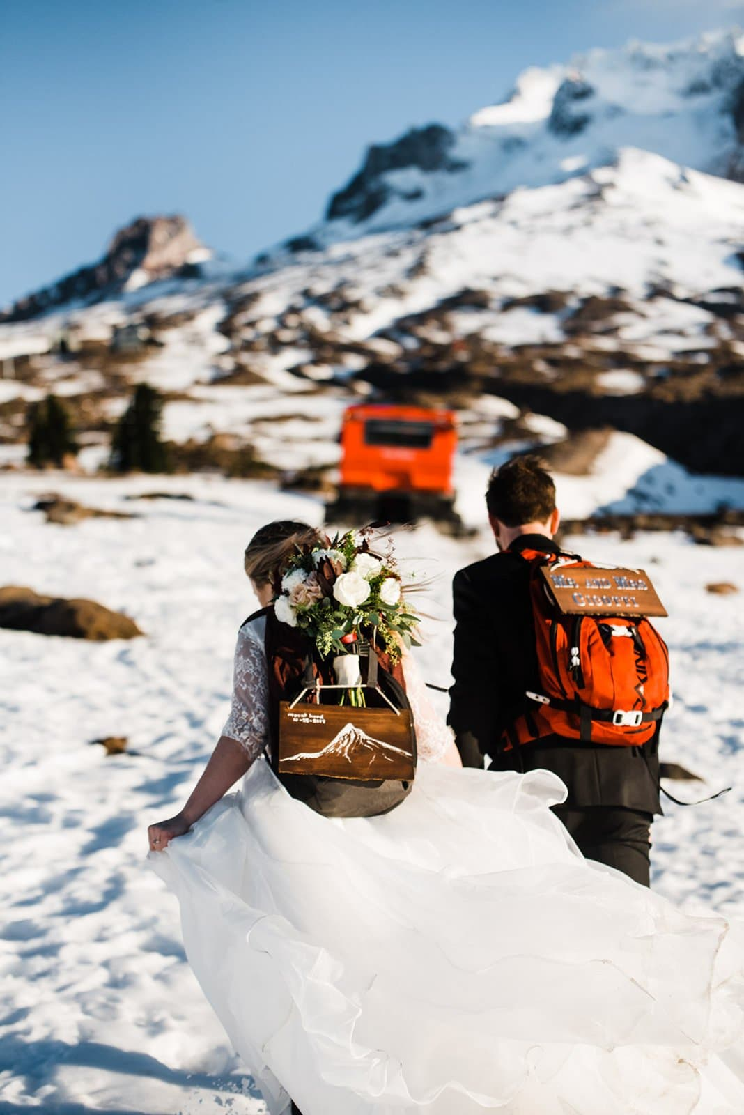 bride and groom hiking