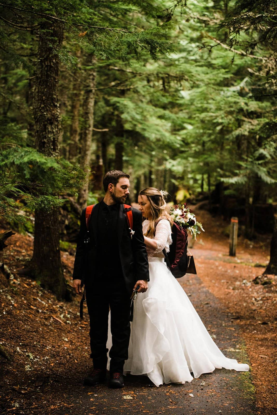 bride and groom during hike