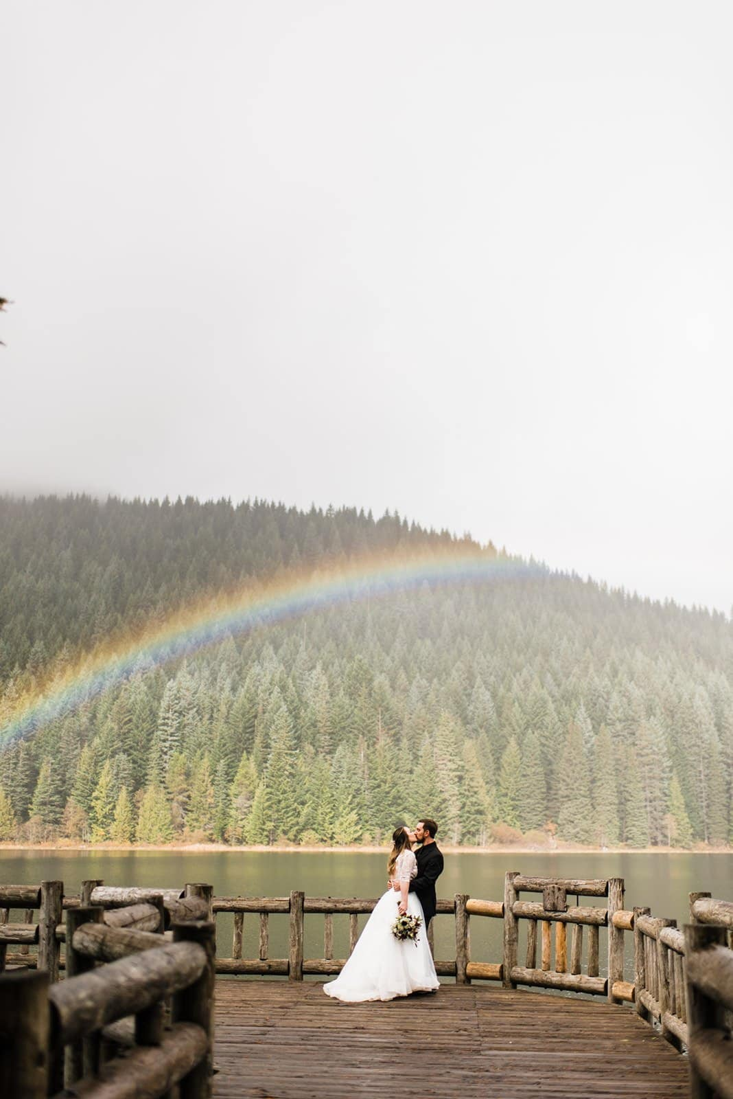 rainbow during mountain elopement