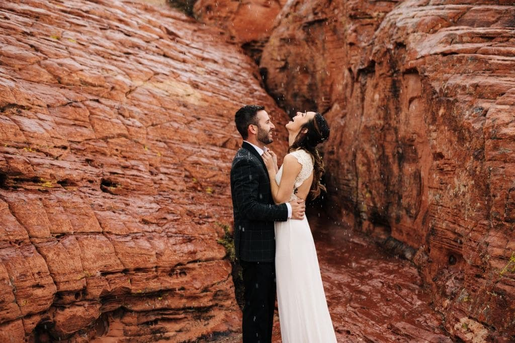 bride and groom keep each other warm at las vegas snowy elopement
