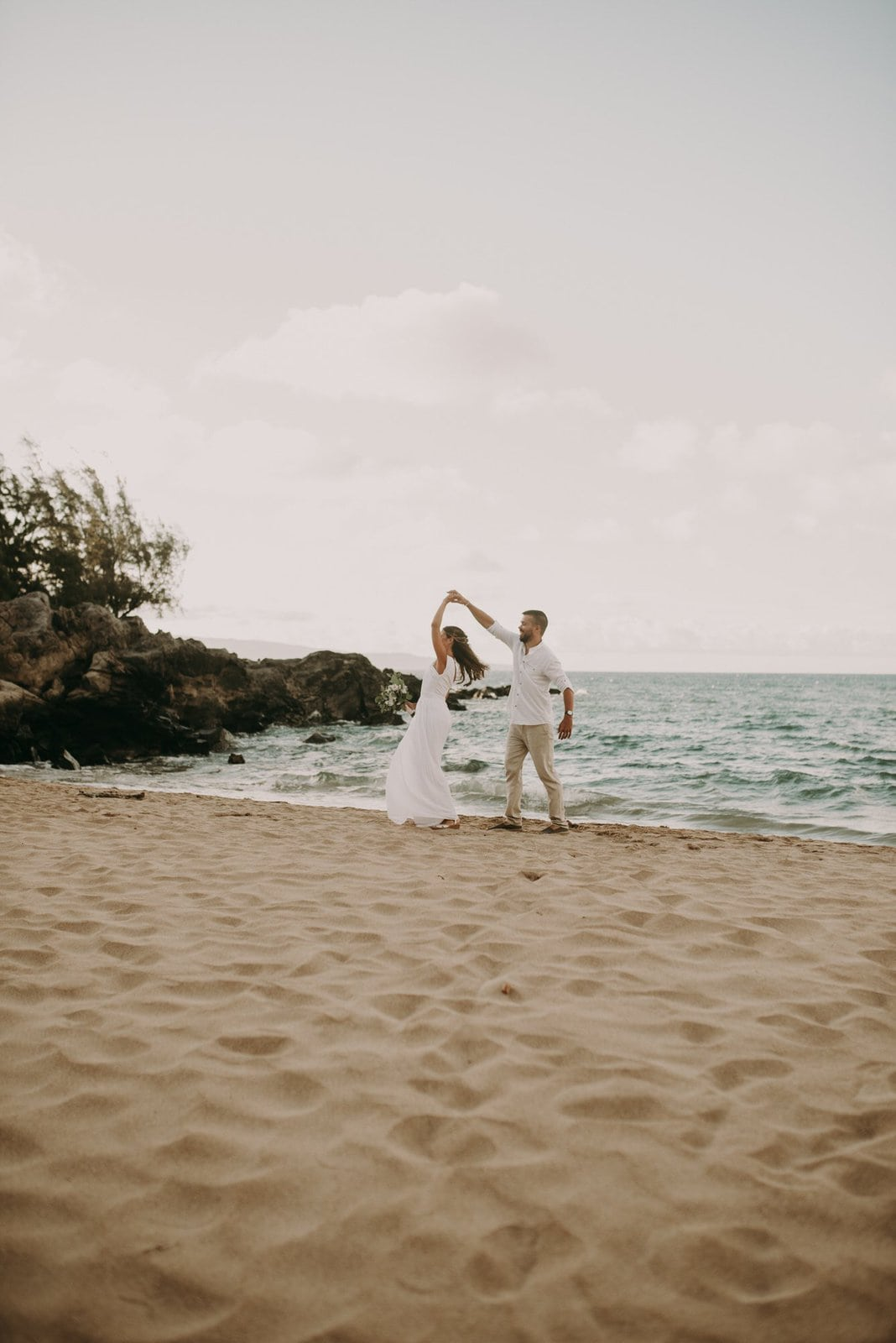 bride and groom dancing in hawaii.