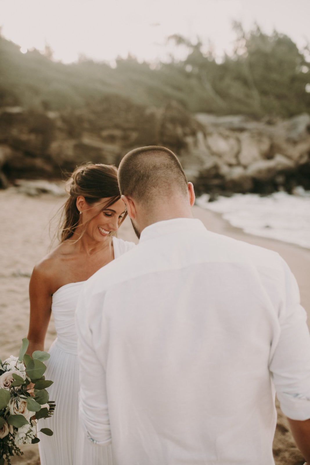 bride and groom smilling