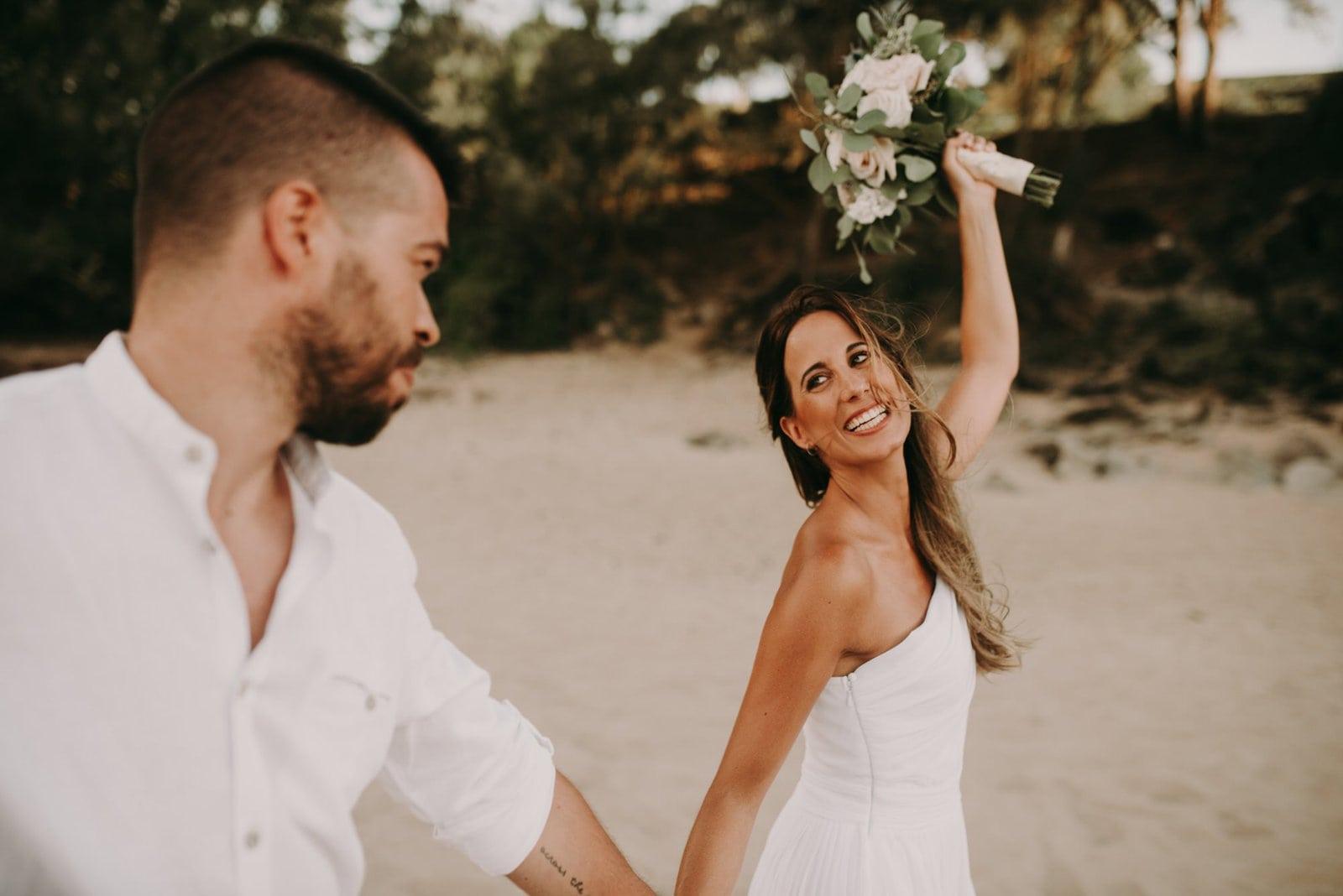 bride celebrating during hawaii elopement