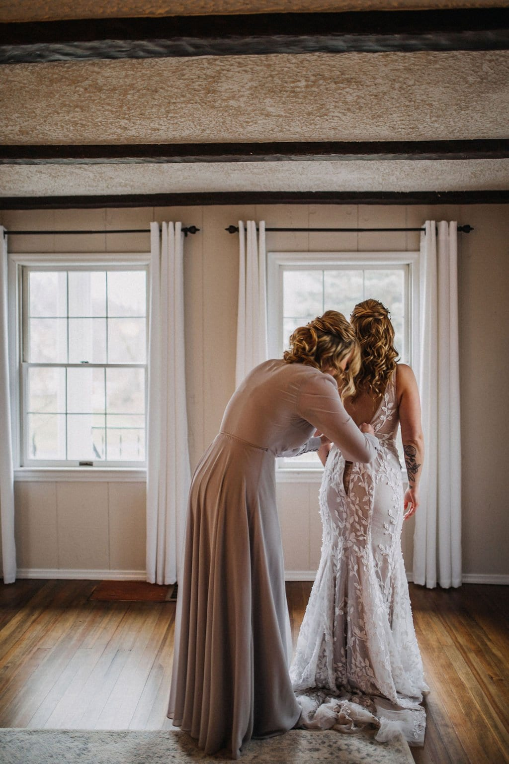matron of honor helping bride