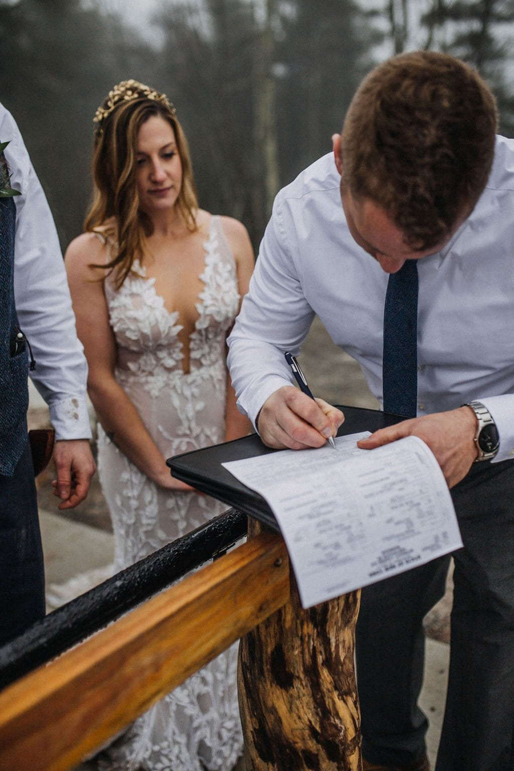 bride and groom sign marriage license