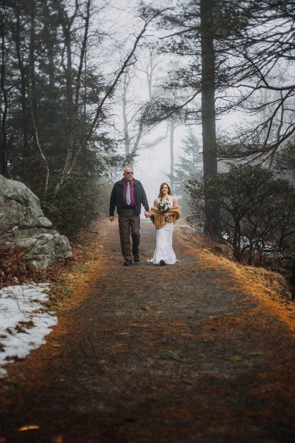 bride walking down the aisle in Minnewaska State Park.