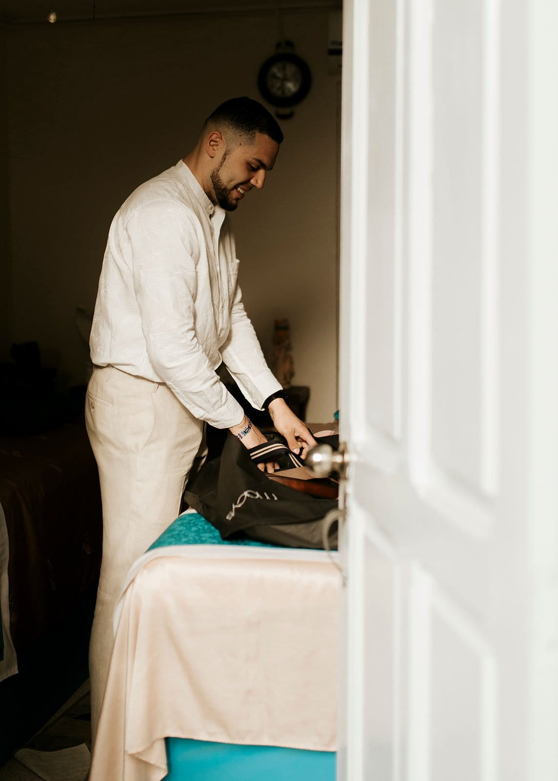 groom getting ready during elopement