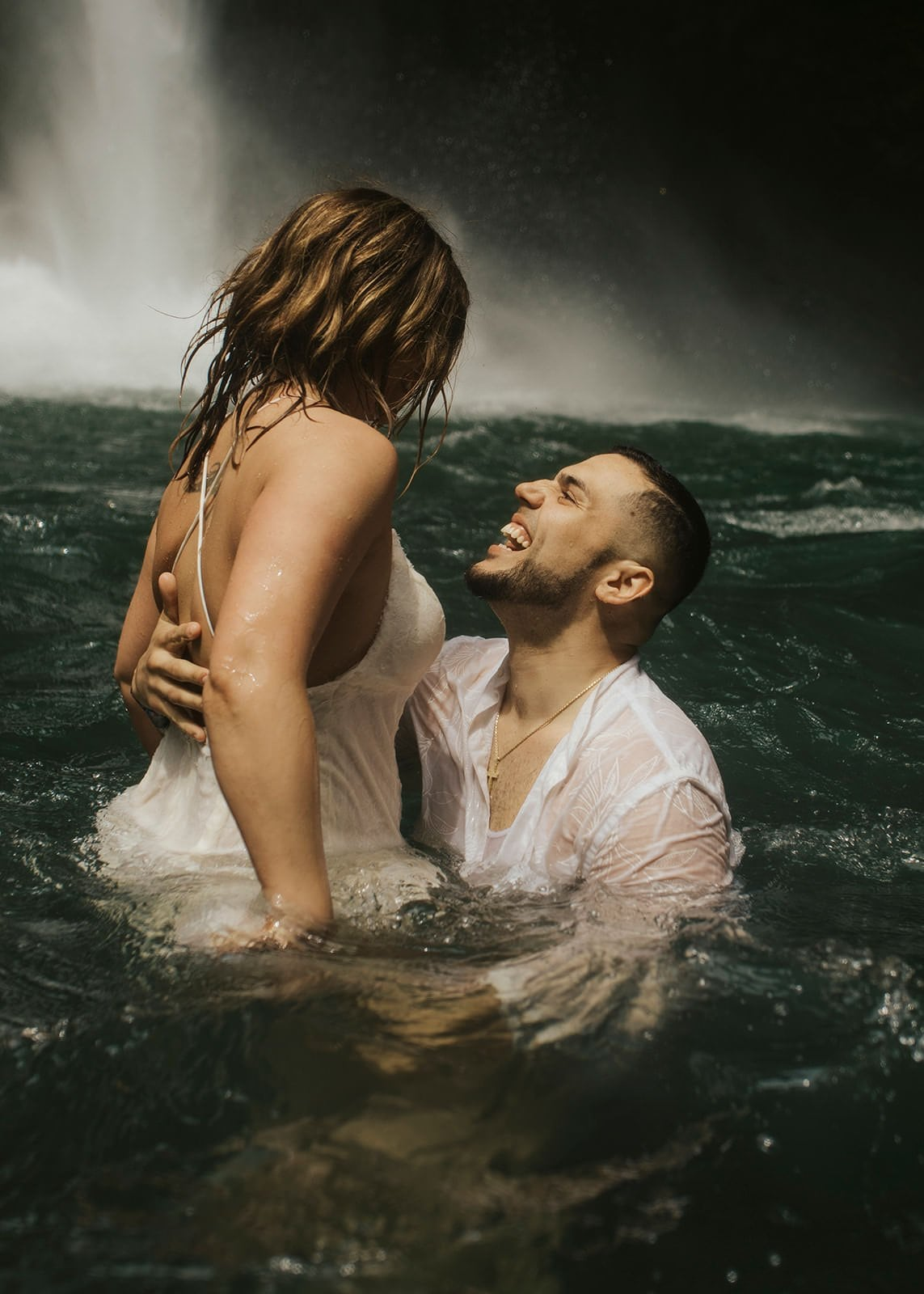 couple having fun during costa rica waterfall elopement