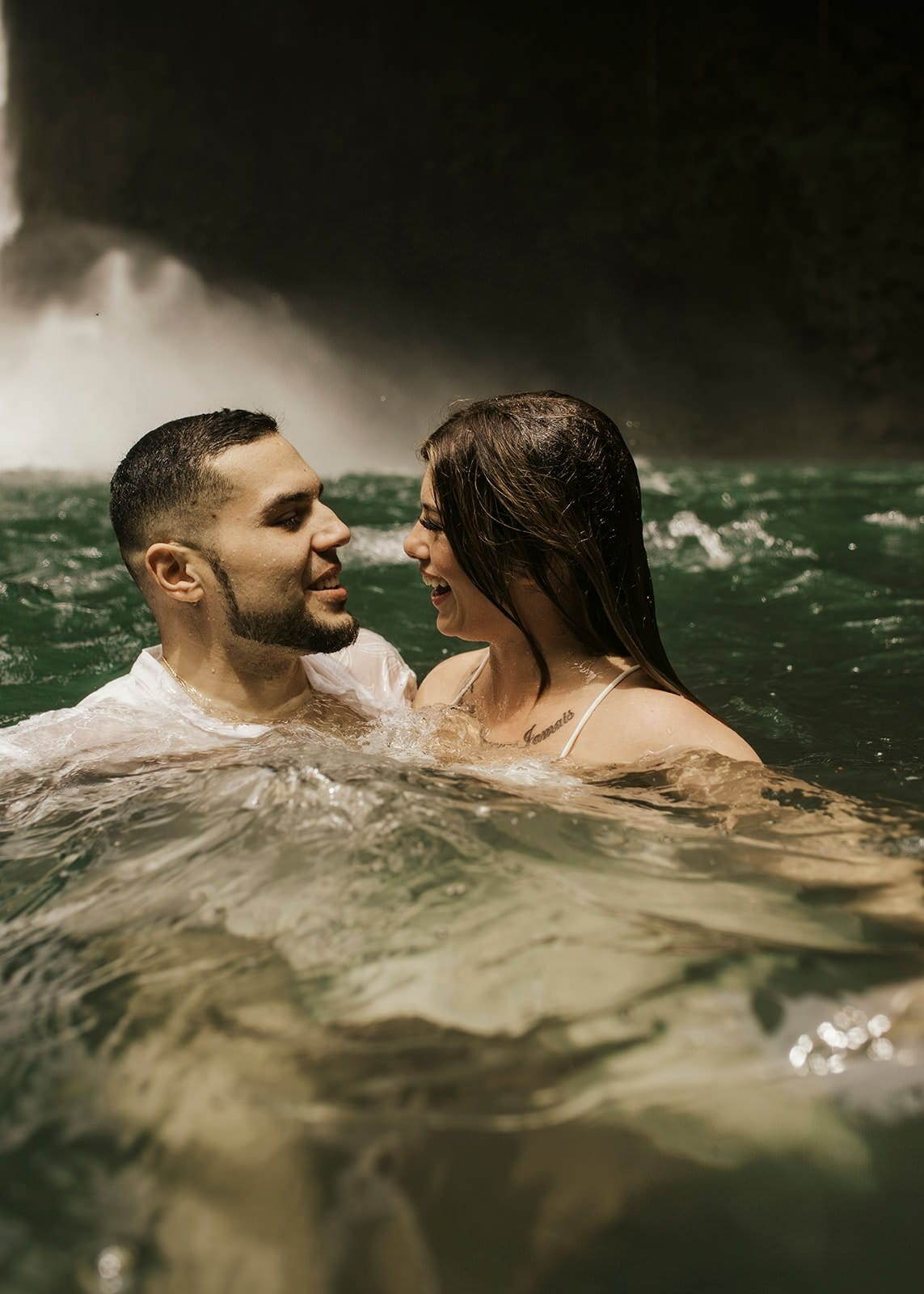 couple in water during costa rica waterfall elopement