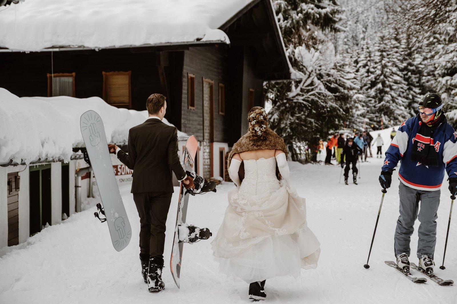 bride and groom go snowboarding