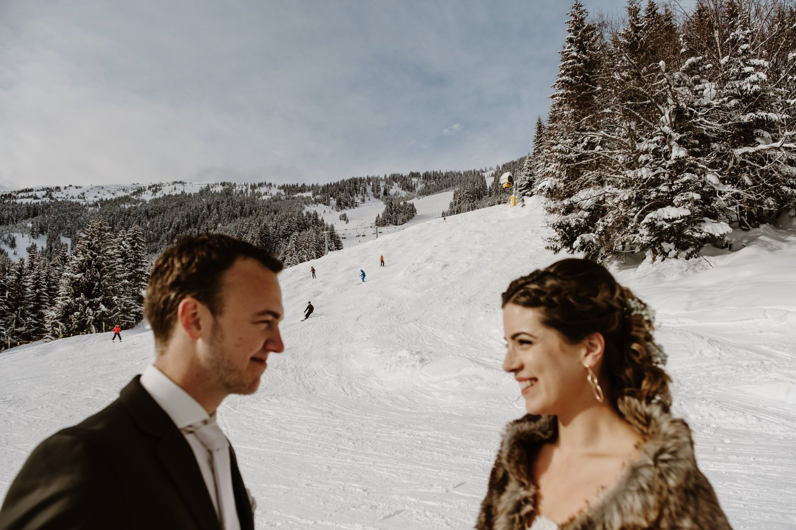 bride and groom at the slopes