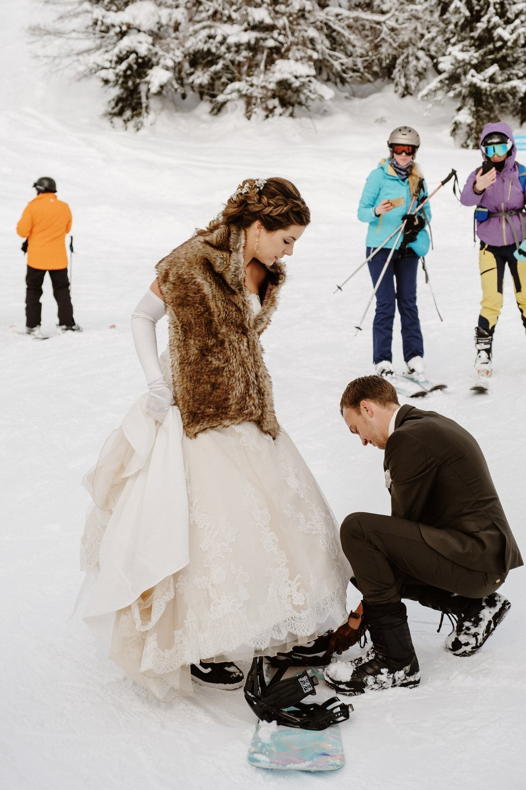 bride and groom at the slopes together