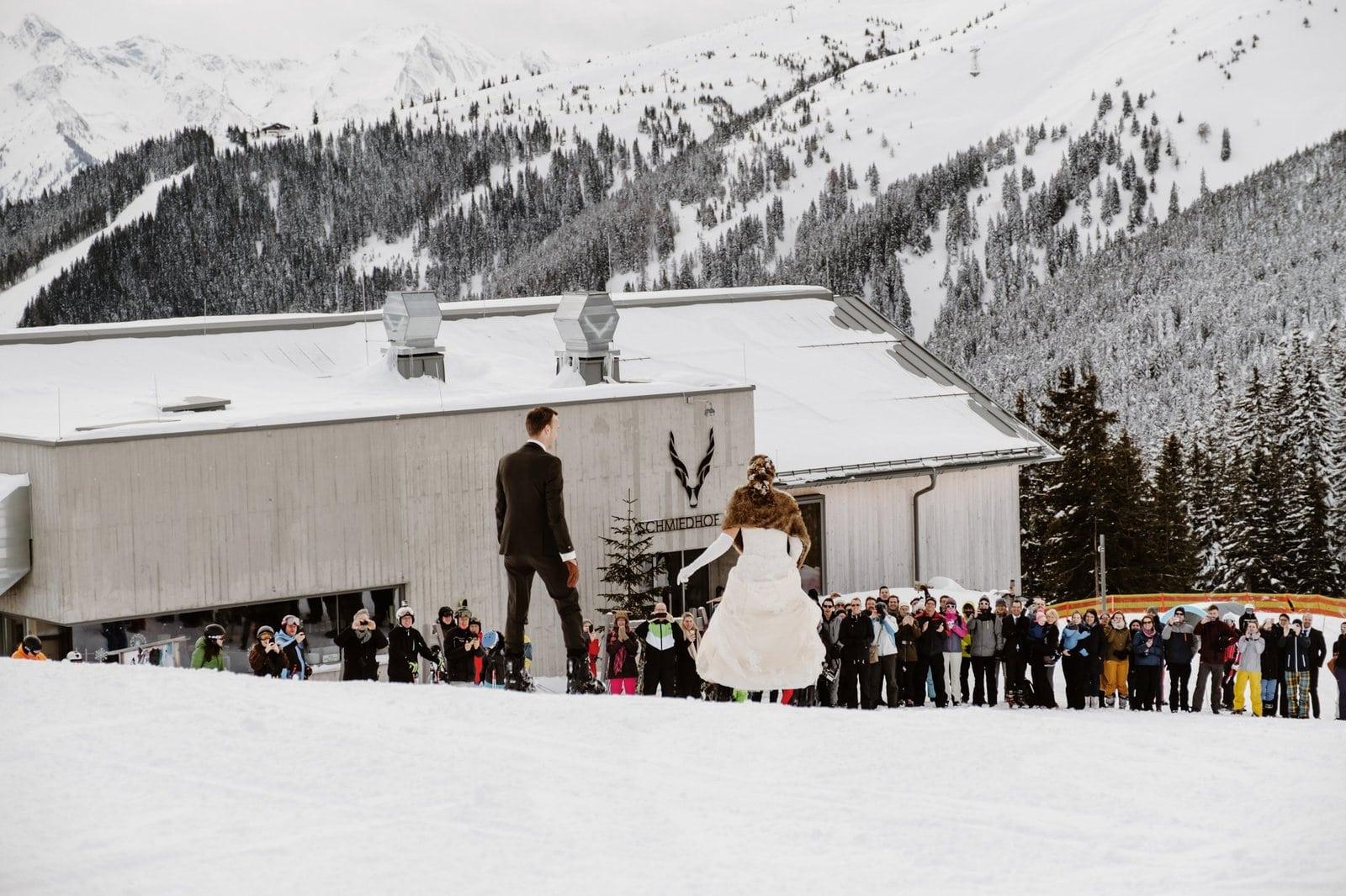 bride and groom snowboarding together