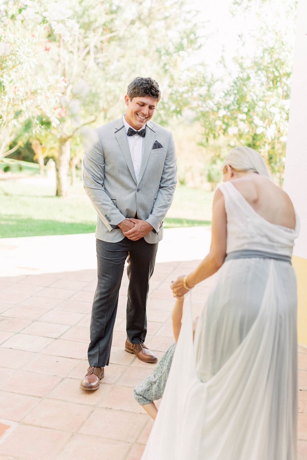 husband sees his wife during vow renewal first look