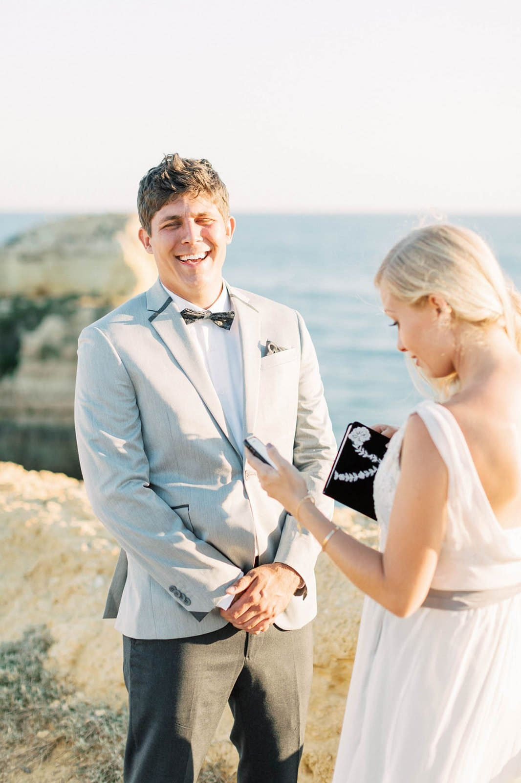husband laughing during vows