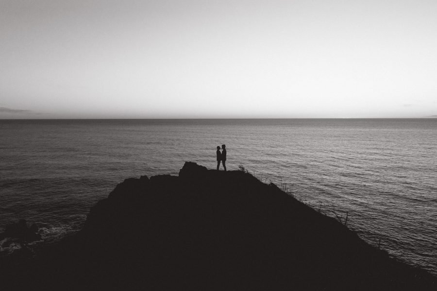 Greg & Nate holding hands as the sun sets on the Oregon Coast