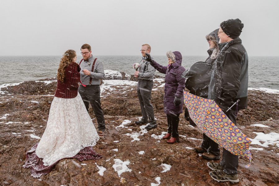 Sharing your wedding ceremony with your closest family and friends during a snowstorm on the North Shore of Minnesota