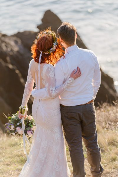 This couple watched the sun set over the Pacific Ocean on the cliffs of the Oregon Coast