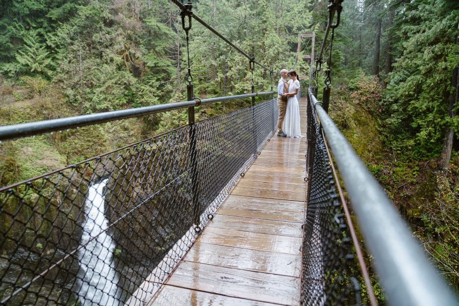 Cuddle on a suspension bridge over a waterfall in the pouring rain...so PNW