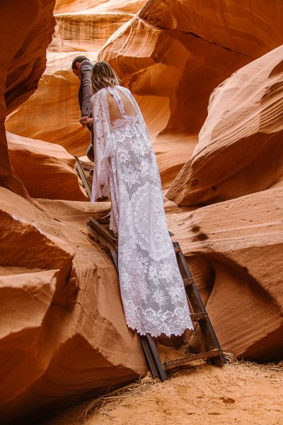 You can have an adventure on your elopement by climbing ladders in slot canyons