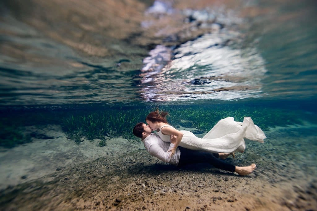 underwater trash the dress wedding session