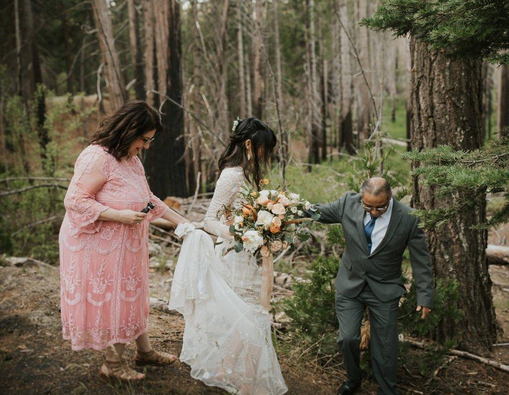 parents helping bride