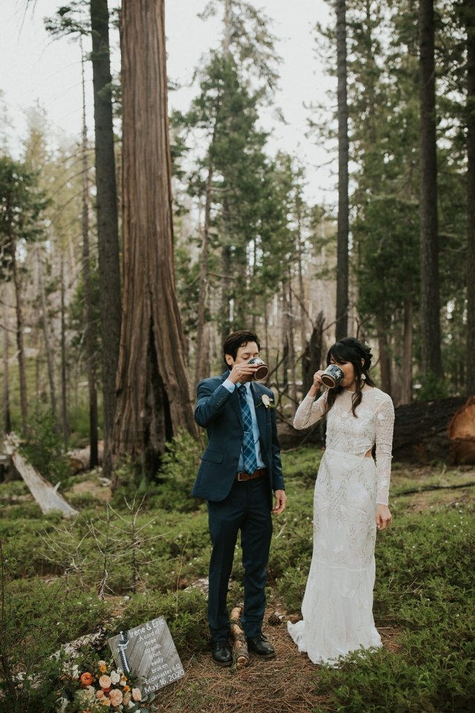couple drinking cider for wedding