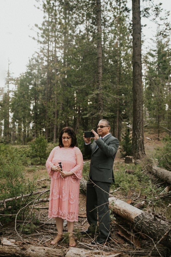 parents recording wedding